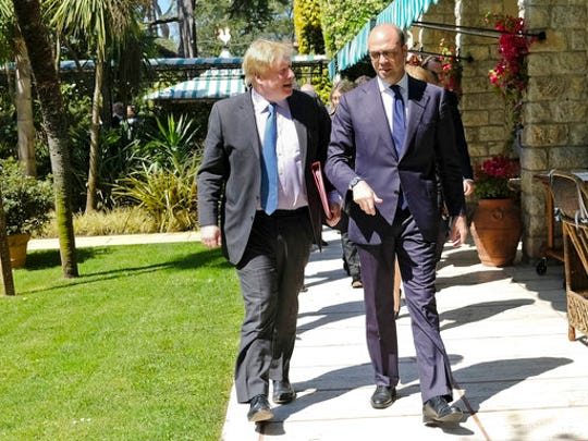 Italian Foreign Minister Angelino Alfano, right, and
