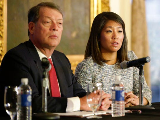 "Crystal Pepper daughter of Dr. David Dao accompanied by attorney Stephen Golan, speaks at a news conference Thursday, April 13, 2017, in Chicago. Dao a passenger dragged from a United Express flight Sunday April 9, 2017, suffered a ""significant"" concussion and broken nose, and he lost two front teeth, attorney Thomas Demetrio said Thursday. Dao was removed from the plane after he refused to give up his seat on the full flight from Chicago to Louisville to make room for four crew members."