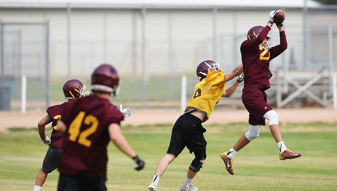 Windsor's Jake Hammond grabs an interception on the first day of practice Monday. The Wizards are the defending 4A champions.