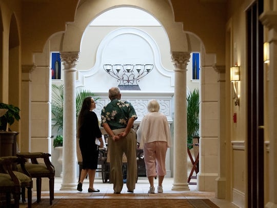Jenna Drese, left, a senior living counselor, at The Terraces at Bonita Springs guides a couple through the community Thursday.