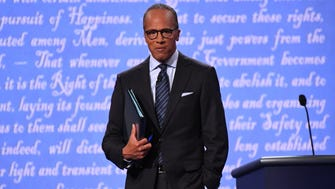 Moderator Lester Holt from NBC takes the stage before the first presidential debate at Hofstra University between Democratic presidential candidate Hillary Clinton and Republican presidential candidate Donald Trump.