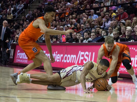 Syracuse's Matthew Moyer, left, and Marek Doleza scramble for a loose ball with Florida State guard CJ Walker in the second half of an NCAA college basketball game in Tallahassee, Fla., Saturday, Jan. 13, 2018. Florida State defeated Syracuse 101-90 in double overtime. (AP Photo/Mark Wallheiser)