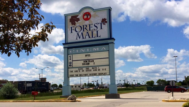 A sign at The Forest Mall Cinema announces its last two movies. The theater will close for good Sunday.