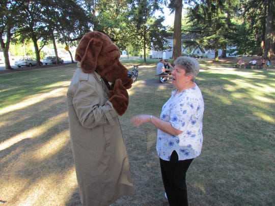 McGruff the Crime Dog gets a lighthearted ribbing at Pioneer Park on Tuesday, Aug. 4, during National Night Out 2015.