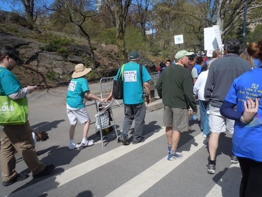 Many people with Parkinson's, wheelchairs or walkers participated in the mile-long Parkinson's Unity Walk.