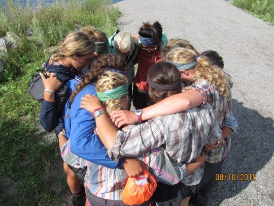 Day 25: Mary Spethmann's crew huddles together as the Les Voyageurs bus arrives. Emotions were mixed, as the crew was excited to see family but wished they didn't have to leave.