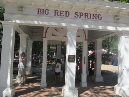 At the Big Red Spring, located near the paddock and on the grounds of Saratoga Race Course, visitors sample the natural mineral waters that Saratoga is famous for.