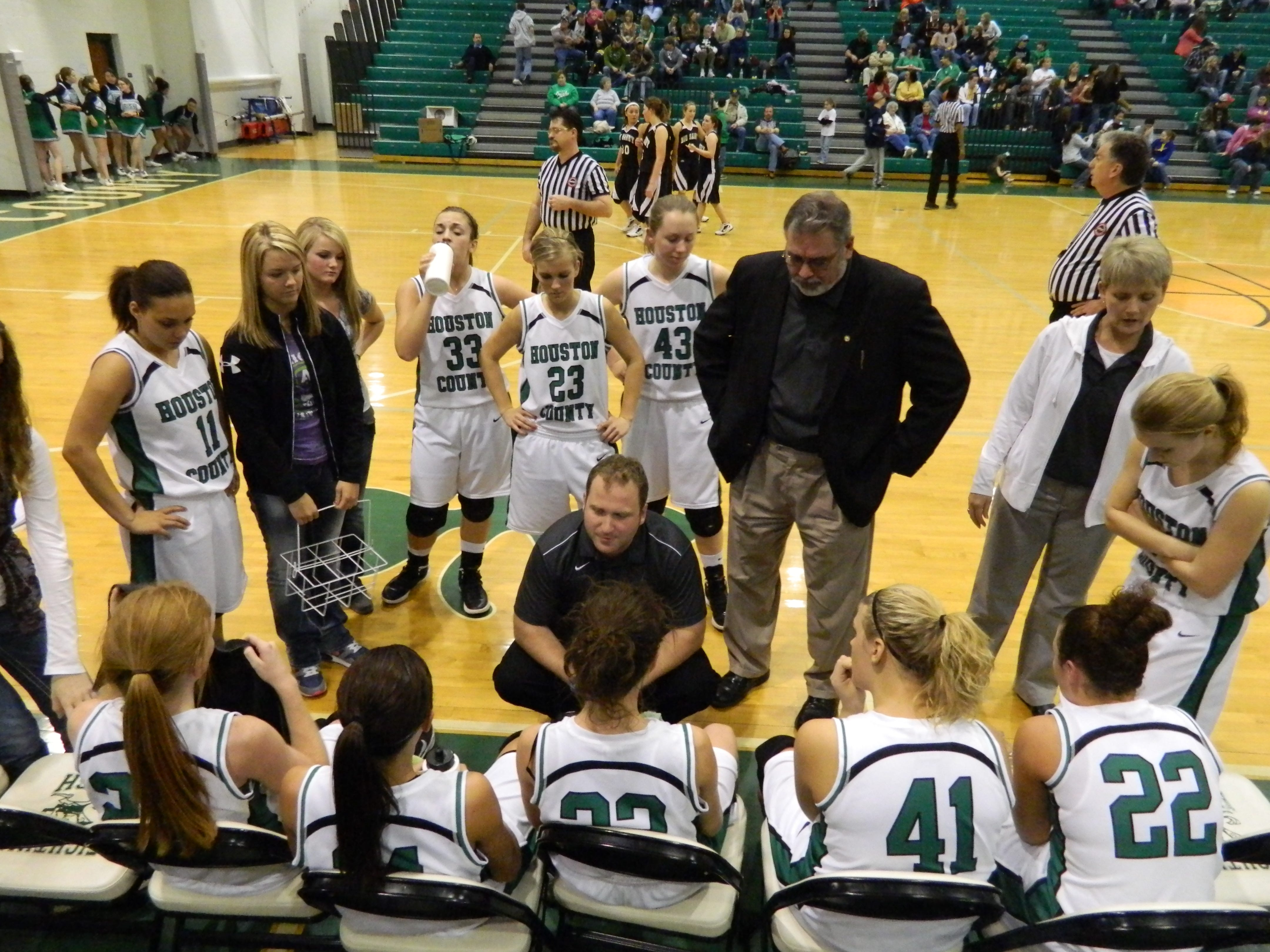 Houston County head basketball coach Sam Young, center, talks with his team during a timeout in a game against Big Sandy last Feburary. Young was named The Leaf-Chronicle All Area Girls Basketball Coach of the Year.