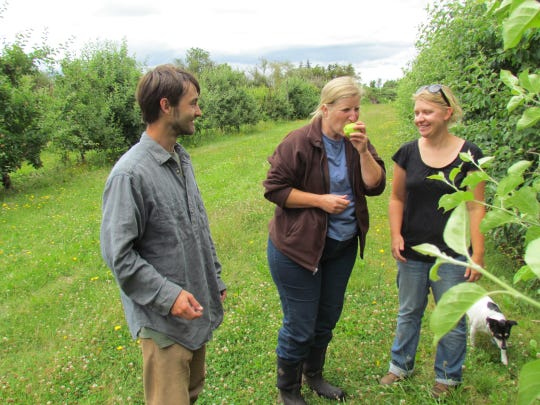 A young couple, Danny (left) and Martina (right) Dalton, recently took over the Scio Farm, applying their degrees in agricultural science. Jeannie Berg of Fertile Ground Farm and Gardens in Independence, is part of the new team.