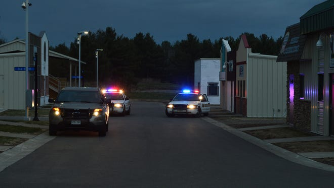 A driver is pulled over as part of a simulated pursuit at the Marathon County Sheriff's Department's Citizens Academy on Wednesday, April 22, 2015.