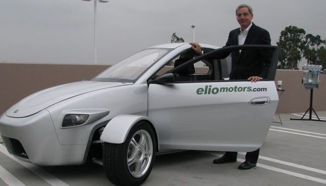 Paul Elio and his three-wheel car
