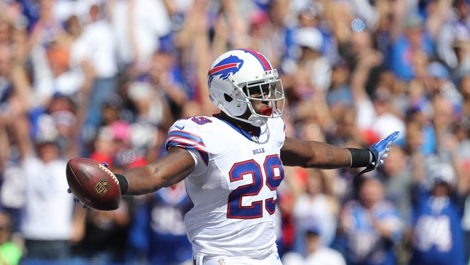Karlos Williams celebrates a first-quarter touchdown against the Patriots.