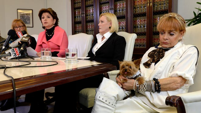 Janice Baker Kinney (L), attorney Gloria Allred,  Marcella Tate, and Autumn Burns at press conference April 23 in Los Angeles to accuse Bill Cosby of drugging and raping them decades ago.