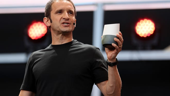 Google Vice President of Product Management Mario Queiroz shows the new Google Home during Google I/O 2016.