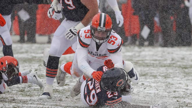 Browns linebacker Joe Schobert defends against Bears running back Tarik Cohen.