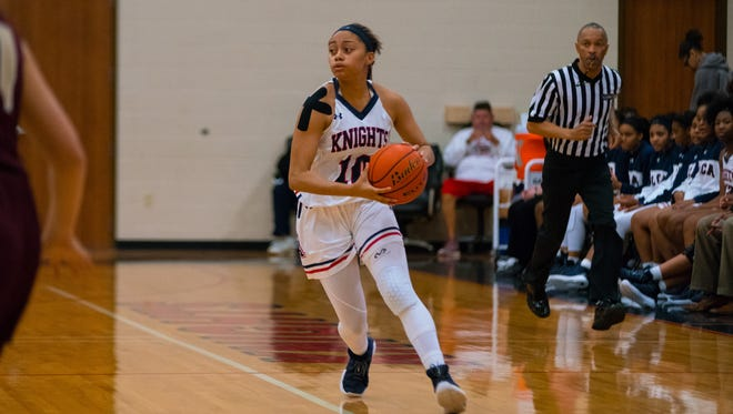 LCA's Megan Abrams scores 29 points to lead the Lady Knights to a 64-39 Division IV state quarterfinal win over Ascension Christian on Thursday.