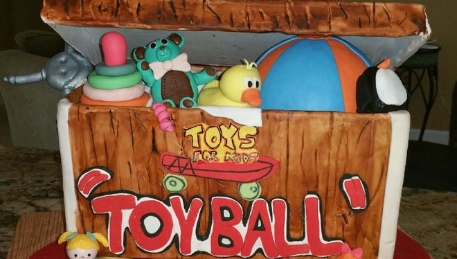 """""""Cake lady"""" Marelyn Elwood of Melbourne, owner of Sweet Inspiration by M.E., created this """"Toy Ball"""" toy box cake."""