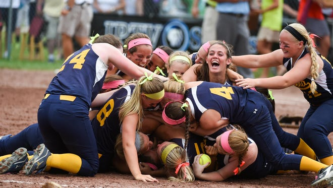 "Iowa City Regina celebrates winning the Class 2A state championsip on Friday. ""The little things win games here at state,"" junior Kennedy Brown said."