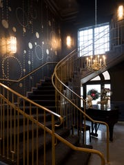 """The ever-popular """"Orangery piano"""" is at the base of the winding staircase at Kitchen 919."""