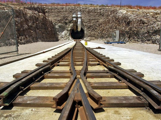 Railroad tracks enter the south portal tunnel entrance of Yucca Mountain, the planned site of a national nuclear waste dump near Mercury. FILE - This June 25, 2002 file photos shows the south portal tunnel entrance of Yucca Mountain, the planned site of  a national nuclear waste dump near Mercury, Nev.