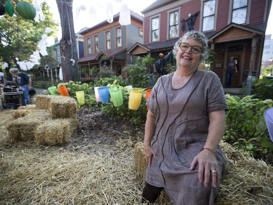 Becky Hostetter, who bought a home in the Cottage Home area for about $500 in 1984, sits on a hay bale during the neighborhood block party Saturday, Oct. 15, 2016. The area, just east of Downtown, has seen higher demand for homes lately.
