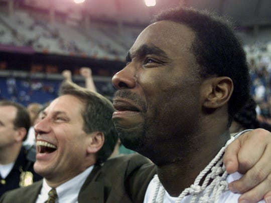 Mateen Cleaves #12 of Michigan State comes to tears while walking off the court with his head coach Tom Izzo after defeating Florida 89-76 to win the final round of the NCAA Men''s Final Four at the RCA Dome in Indianapolis, Indiana.