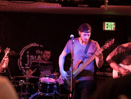 Local metal band prypiat plays live.
