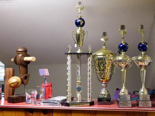 Some of the Rue family's trophies won in foosball matches