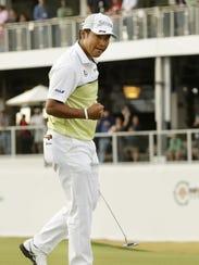 Hideki Matsuyama makes his birdie putt to win the Waste