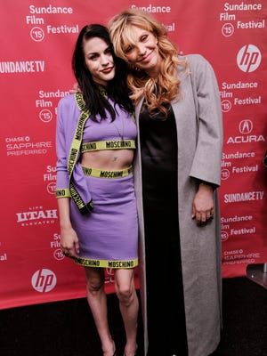"""Frances Bean Cobain has reconciled with her mother, Courtney Love. The two pose at the Sundance premiere of """"Kurt Cobain: Montage of Heck,"""" in January."""