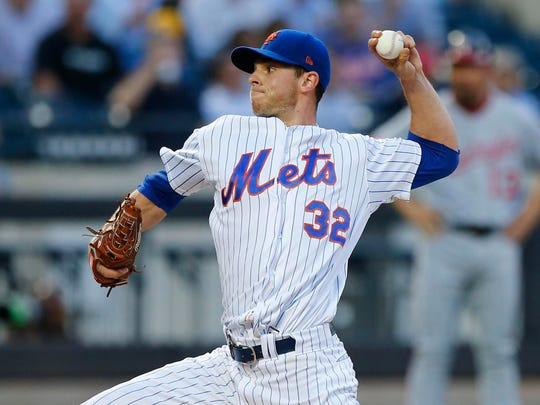 Jul 12, 2018; New York City, NY, USA;  New York Mets starting pitcher Steven Matz (32) pitches in the third inning against the Washington Nationals at Citi Field.