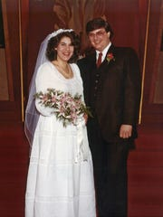 This May 1983 photo provided by Rick Muscoplat shows Jill and Deven Black at their wedding in St. Paul, Minn. In 2013 they marked their 30th anniversary, had a son in college, a home in Nyack, N.Y., and Deven Black would be awarded a national prize for best school librarian. But the seeds of his decline were germinating.