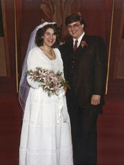 This May 1983 photo provided by Rick Muscoplat shows Jill and Deven Black at their wedding in St. Paul, Minn. In 2013 they marked their 30th anniversary, had a son in college, a home in Nyack, N.Y., and Deven Black would be awarded a national prize for best school librarian. But the seeds of his decline were germinating. (Rick Muscoplat via AP)