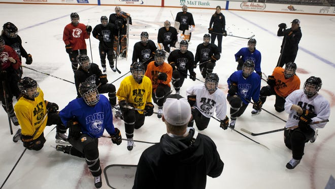 The RIT women's hockey team listens to assistant coach Matt Woodard during practice in the Polisseni Center, the team's new arena on campus, in this October file photo.