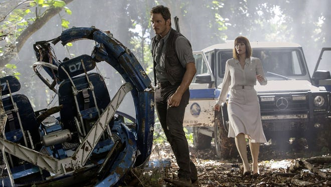 """Chris Pratt and Bryce Dallas Howard go in search of her missing nephews in """"Jurassic World."""""""