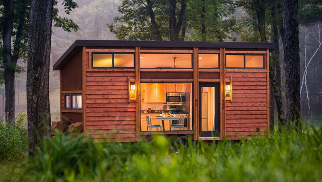 The 269-square foot ESCAPE Traveler travels like an RV but resembles a cabin in appearance because of its cedar siding.