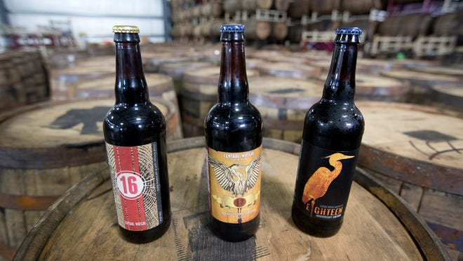 "Demand for Central Waters Brewing's barrel-aged anniversary beers has grown rapidly since ""16"" (left) won gold at the 2014 World Beer Cup.  ""Seventeen"" (middle) sold out in days for last year's release party and ""Eighteen"" (right) sold out in minutes."
