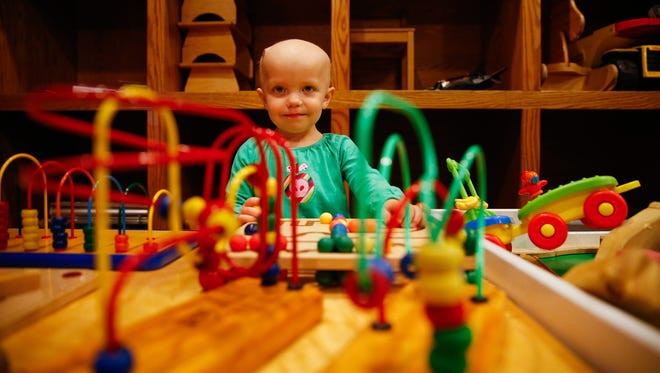 Kaydence Weaver, 2, who is suffering from a childhood cancer, plays in the playroom at The Ronald McDonald House on Sept. 19, 2016. Weaver has been in treatment at Riley Hospital and Peyton Manning Children's Hospital.