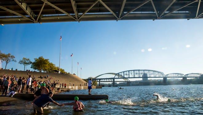 Swimmers finish the Bill Keating, Jr. Great Ohio River Swim at the Public Landing Sunday, September 24, 2017.