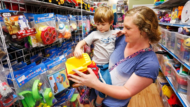 Frankie Sechriest and her two-year-old son, Emmett, look at toy trucks and cars Thursday, October 5, 2017, at Once Upon A Child, 124 Farabee Drive North in Lafayette. Sechriest is from Illinois visiting relatives in Lafayette.