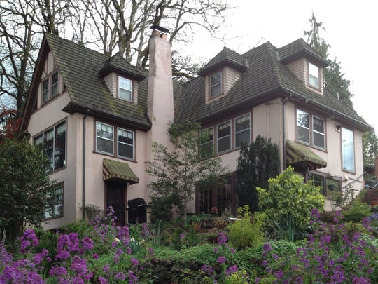 This 1918 European-style farmhouse in South Salem is being restored and renovated by Harold and Jean Wood.