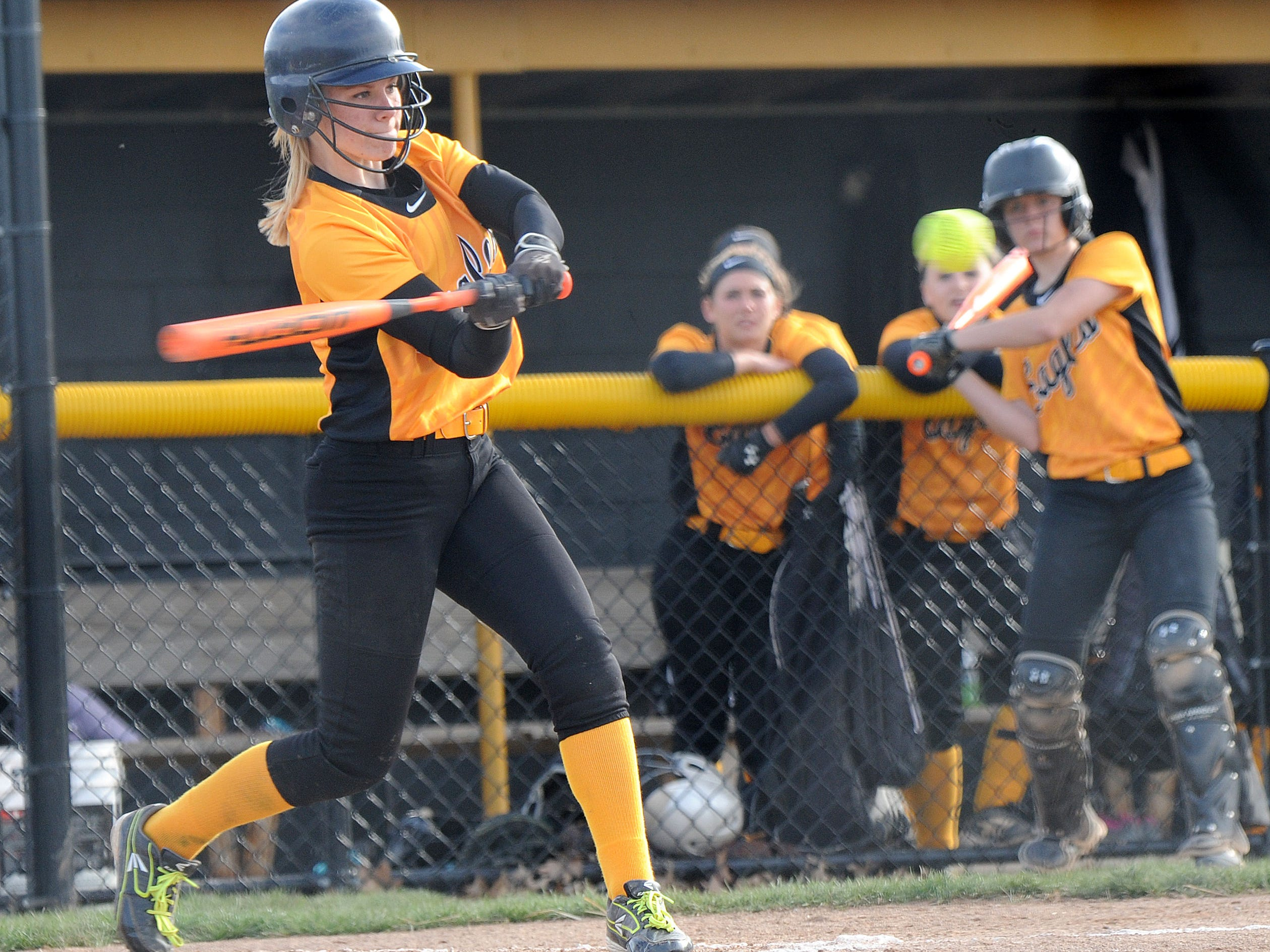 Colonel Crawford's Kerri Reynolds makes contact with the pitch for a home run in the second inning during their game against Bucyrus Wednesday evening.