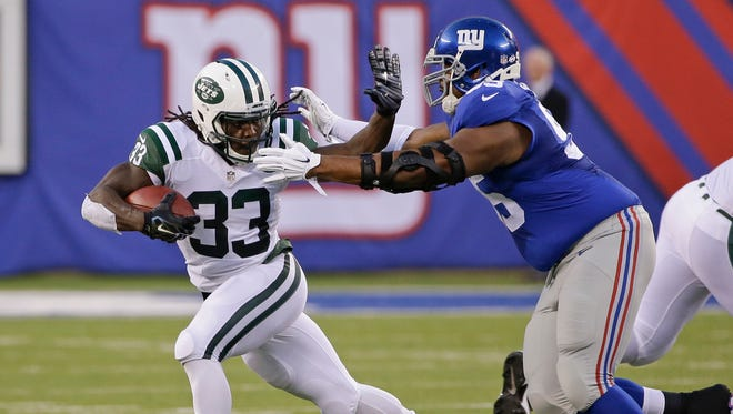 New York Jets running back Chris Ivory struggles against New York Giants tackle Will Beatty during the first half of a preseason Aug. 29, 2015, in East Rutherford, N.J. Beatty is a free agent.