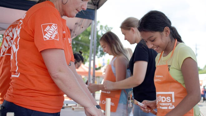 Home Depot volunteers helped kids build  mini white board at the ALERT CDC Family Fun Fest in Smyrna, TN on Saturday, August, 4, 2018.