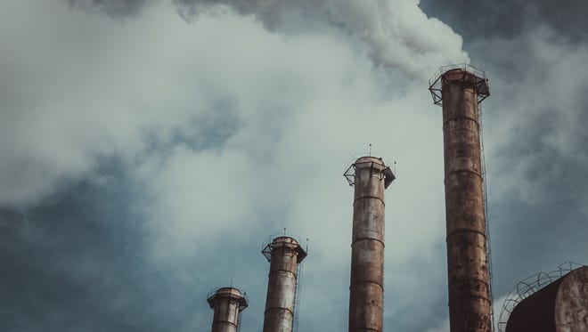 Carbon emissions from a power plant.