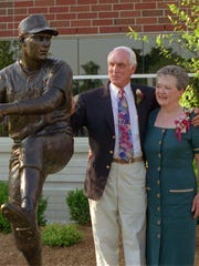 Baseball great Carl Erskine and wife Betty stand next to the statue of him outside St. John's Hospital in Anderson.