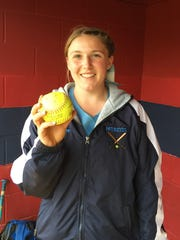 John Jay's Ally Muller poses with the game ball following a no-hitter against Roy C. Ketcham