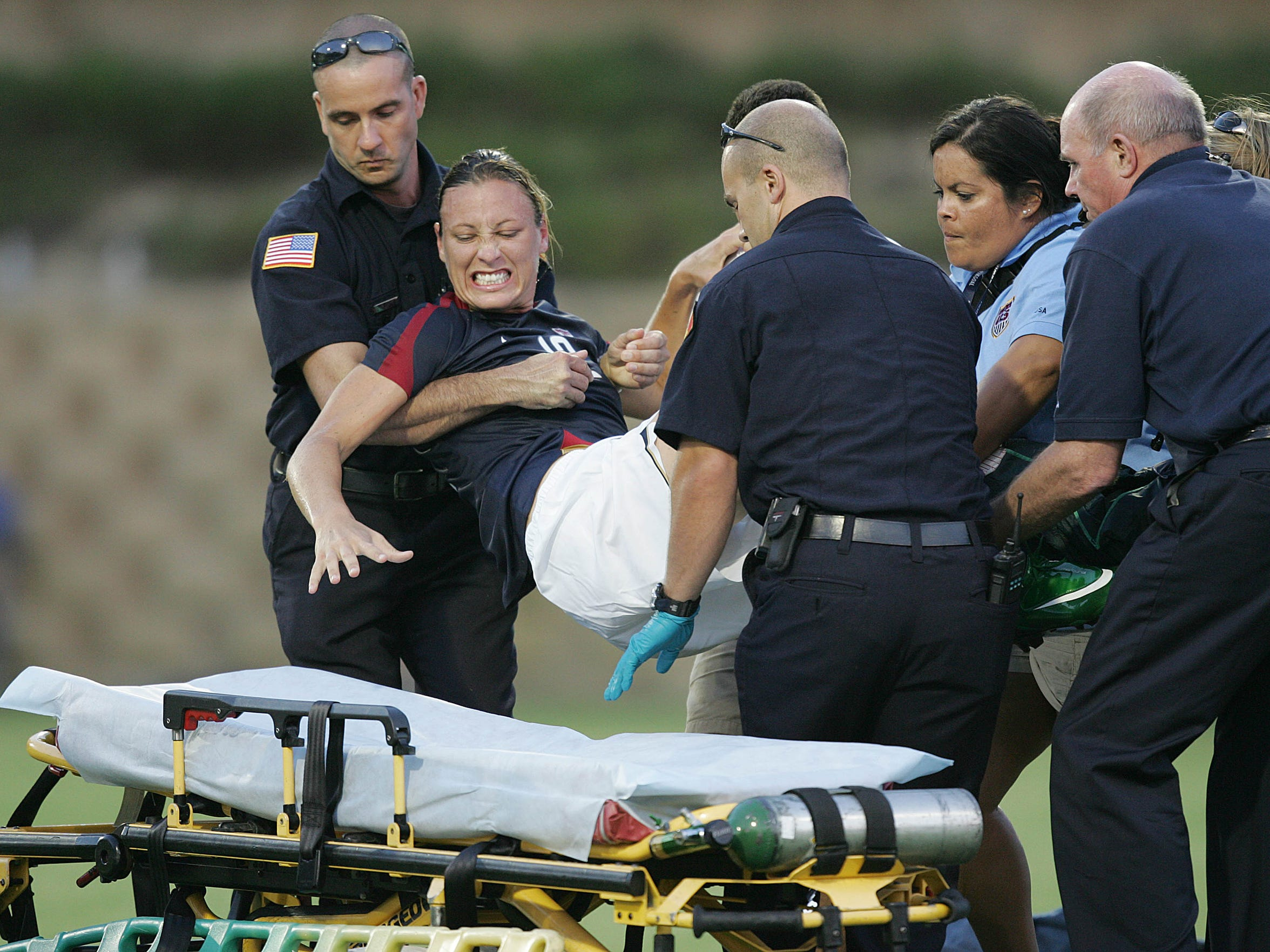 Abby Wambach is hit hard by a Brazilian player and taken off the field by a stretcher during a game July 16, 2008 in San Diego.