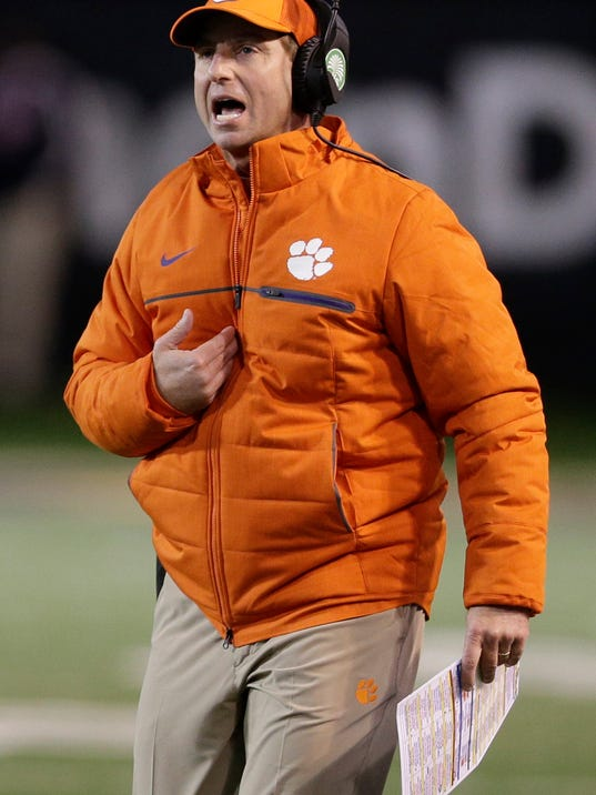 FILE - In this Nov. 19, 2016, file photo, Clemson head coach Dabo Swinney shouts to officials in the first half of an NCAA college football game against Wake Forest, in Winston-Salem, N.C. Swinney and Virginia Tech's Justin Fuente will be on opposite sidelines in Saturday's ACC Championship game, but they were almost much closer than that: Then the offensive coordinator at TCU, Fuente was a finalist in 2011 when Swinney was looking for a young and innovative coach to direct the Tigers' offense. (AP Photo/Chuck Burton, File)