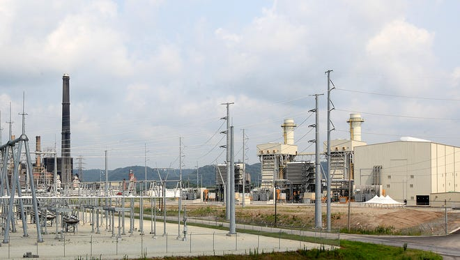 LG&E and KU Energy's new Cane Run natural gas power plant next to its old, now retired coal-burning plant. July 6, 2015